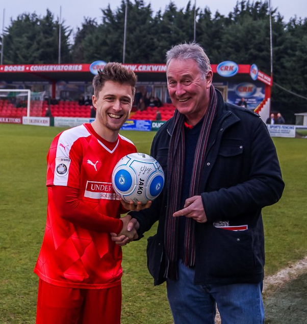 Andy King presents Jake Robinson with the match ball for his hat-trick