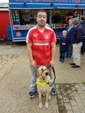 Tudors fan Colin and his guide dog Sid